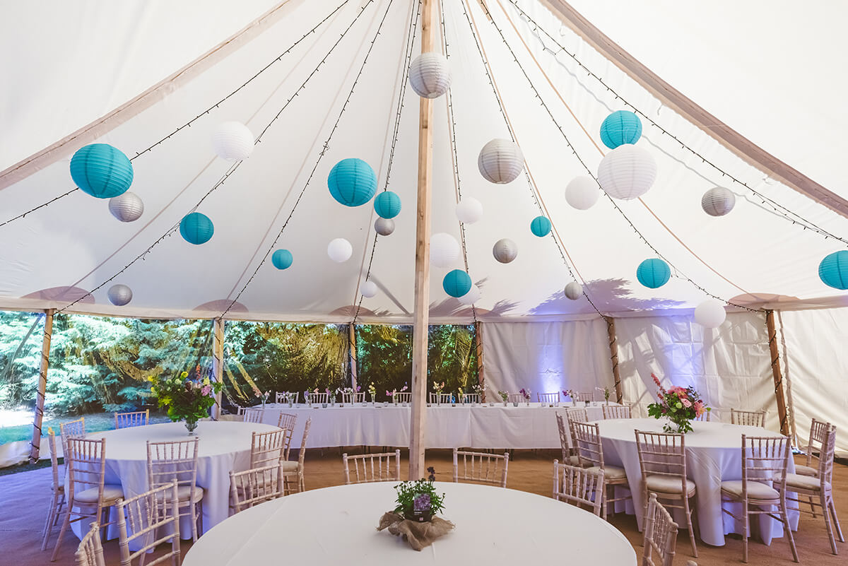 Limewash Chiavari chairs with round tables in Country Tipis Celeste Marquee