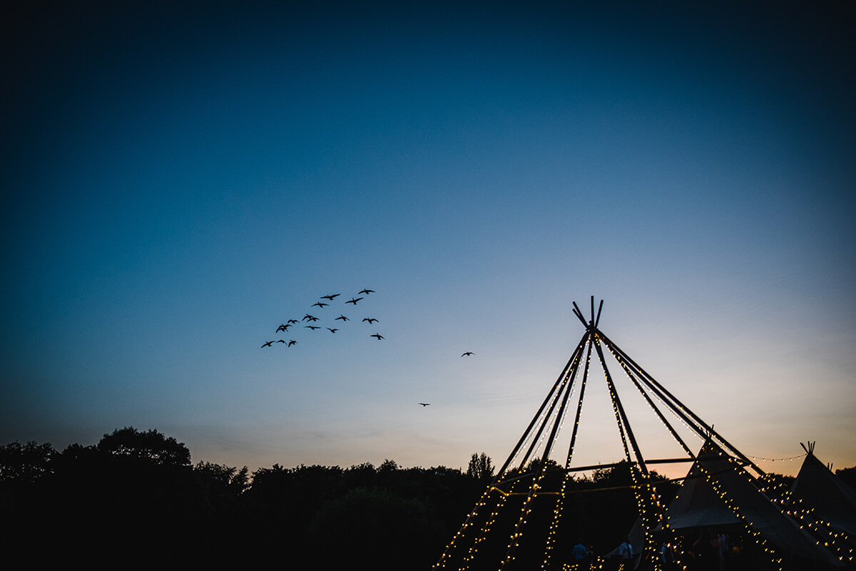 Naked Tipi with birds outside a Teepee Wedding in Hertfordshire