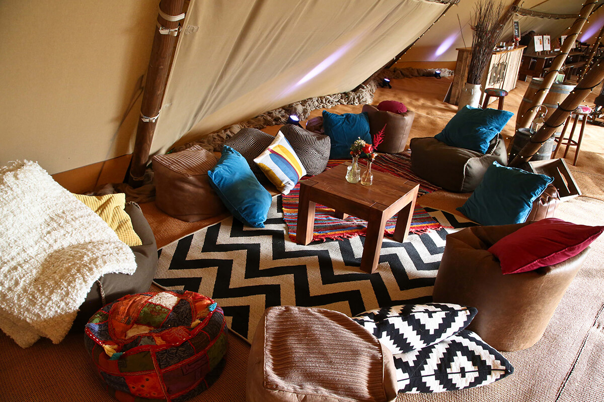 Chillout area inside a giant tipi at a party wedding corporate