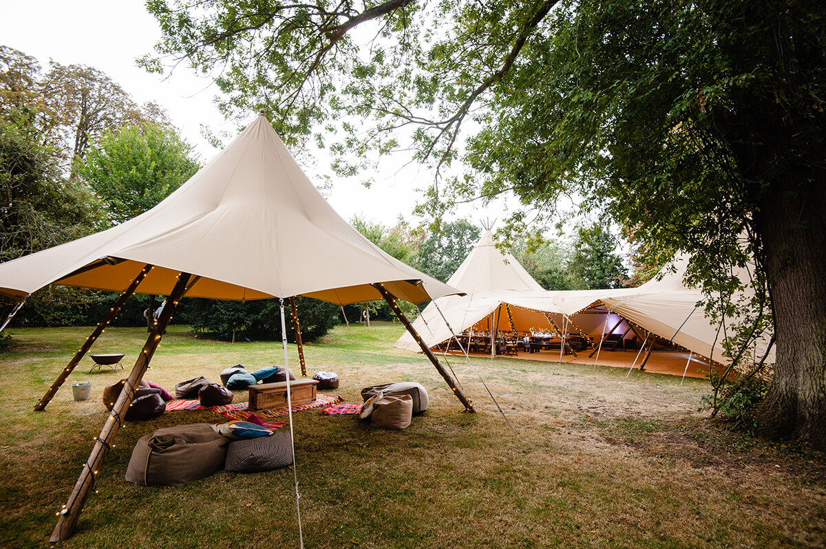 Chill out area alongside two tipis at Island Hall in Godmanchester