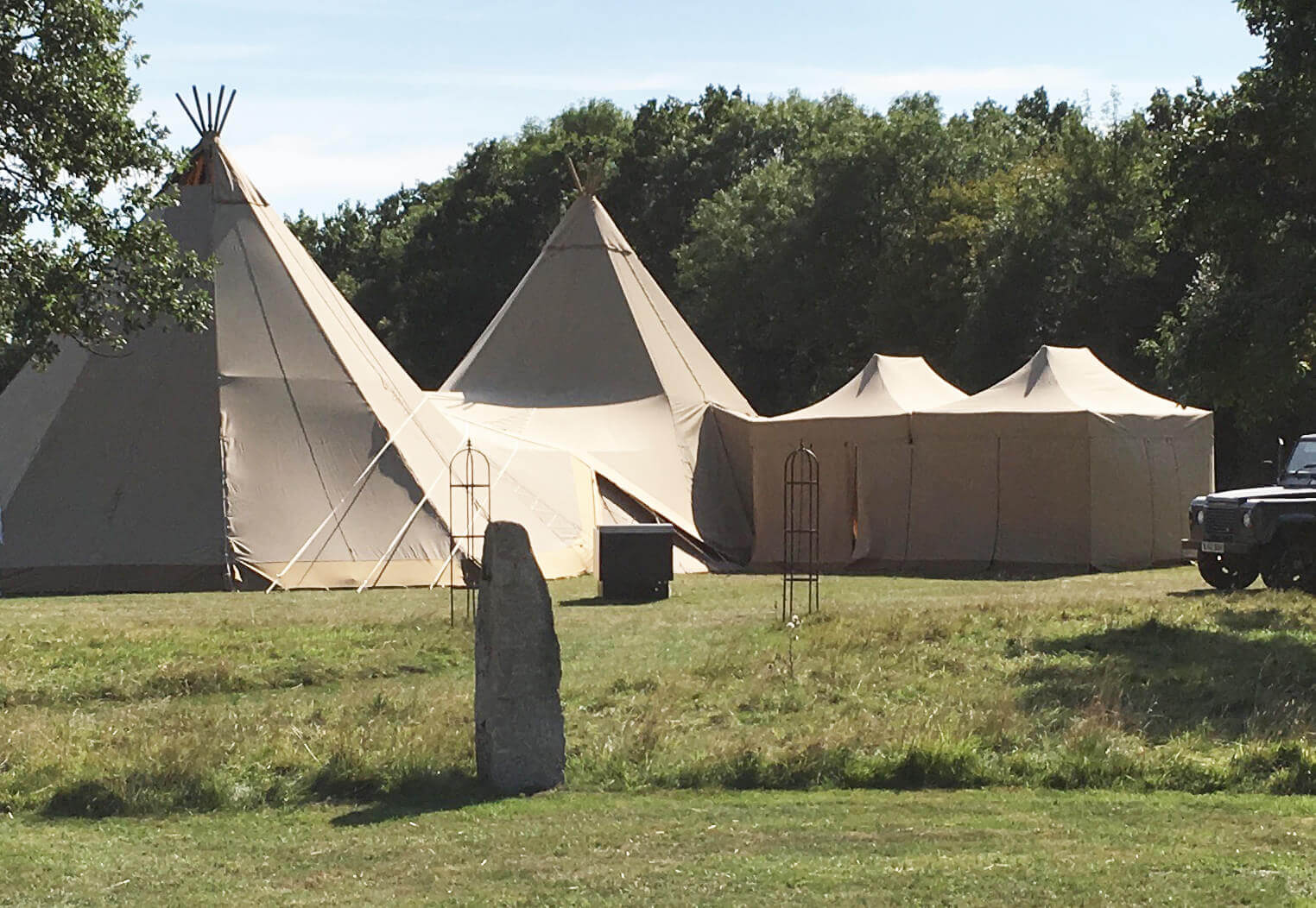 Catering Tent joined onto Tipis at a wedding