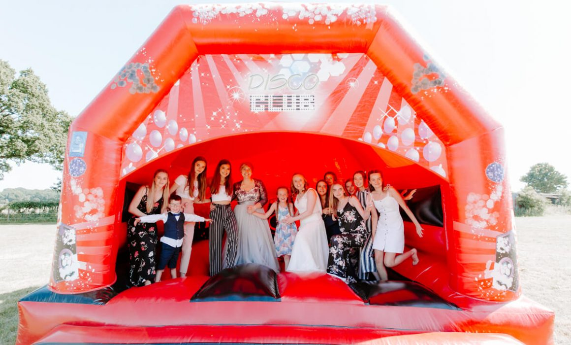 Guests enjoying the bouncy castle at a wedding party