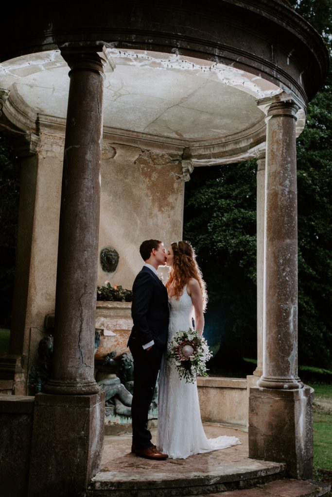 Couple photos between the pillars at Vanstone Park Venue