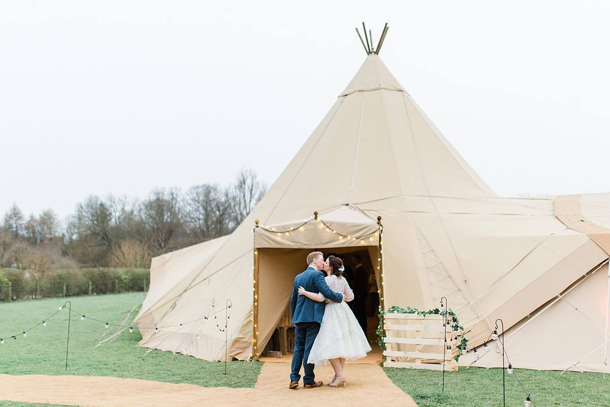 Tipi entrance porch with bride and groom beneath