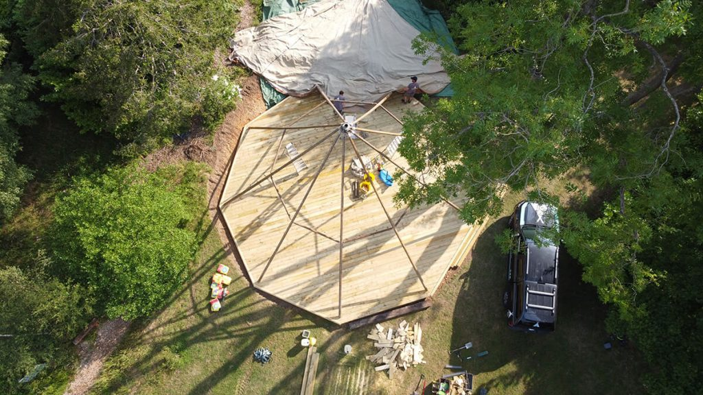 Drone shot of Tipi being erected at a school