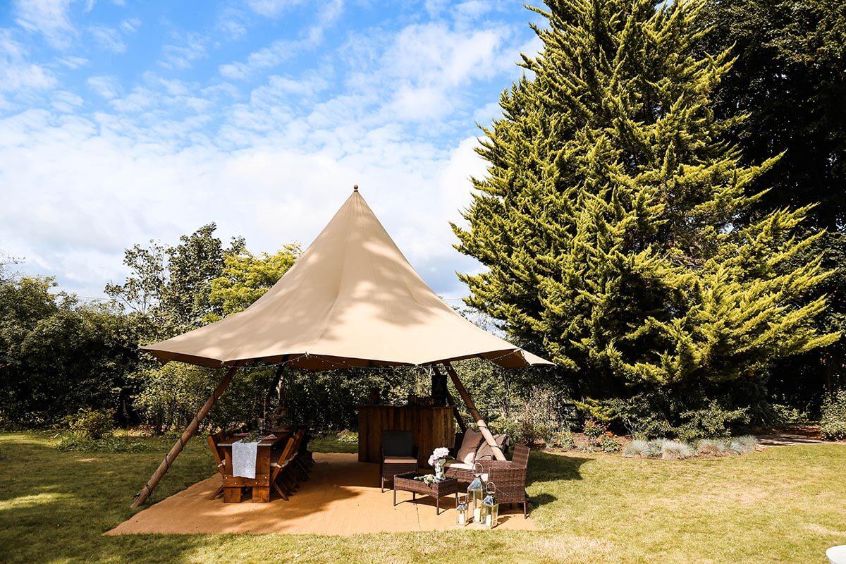 Nimbus Tipi in action for a garden wedding reception