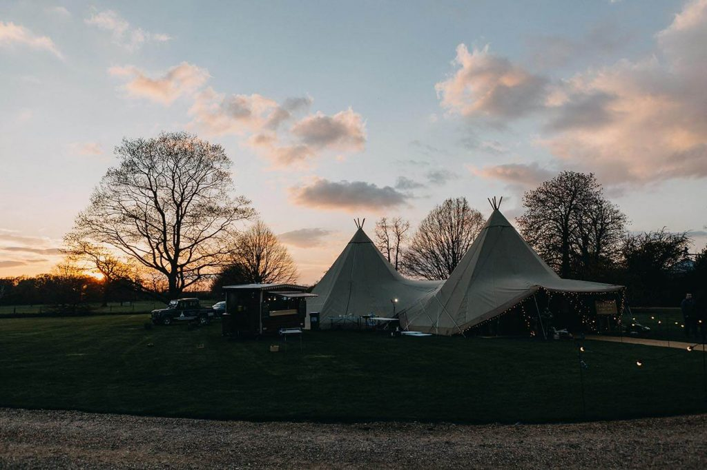 Dusk falls on a Tipi Wedding at Walkern Hall in April
